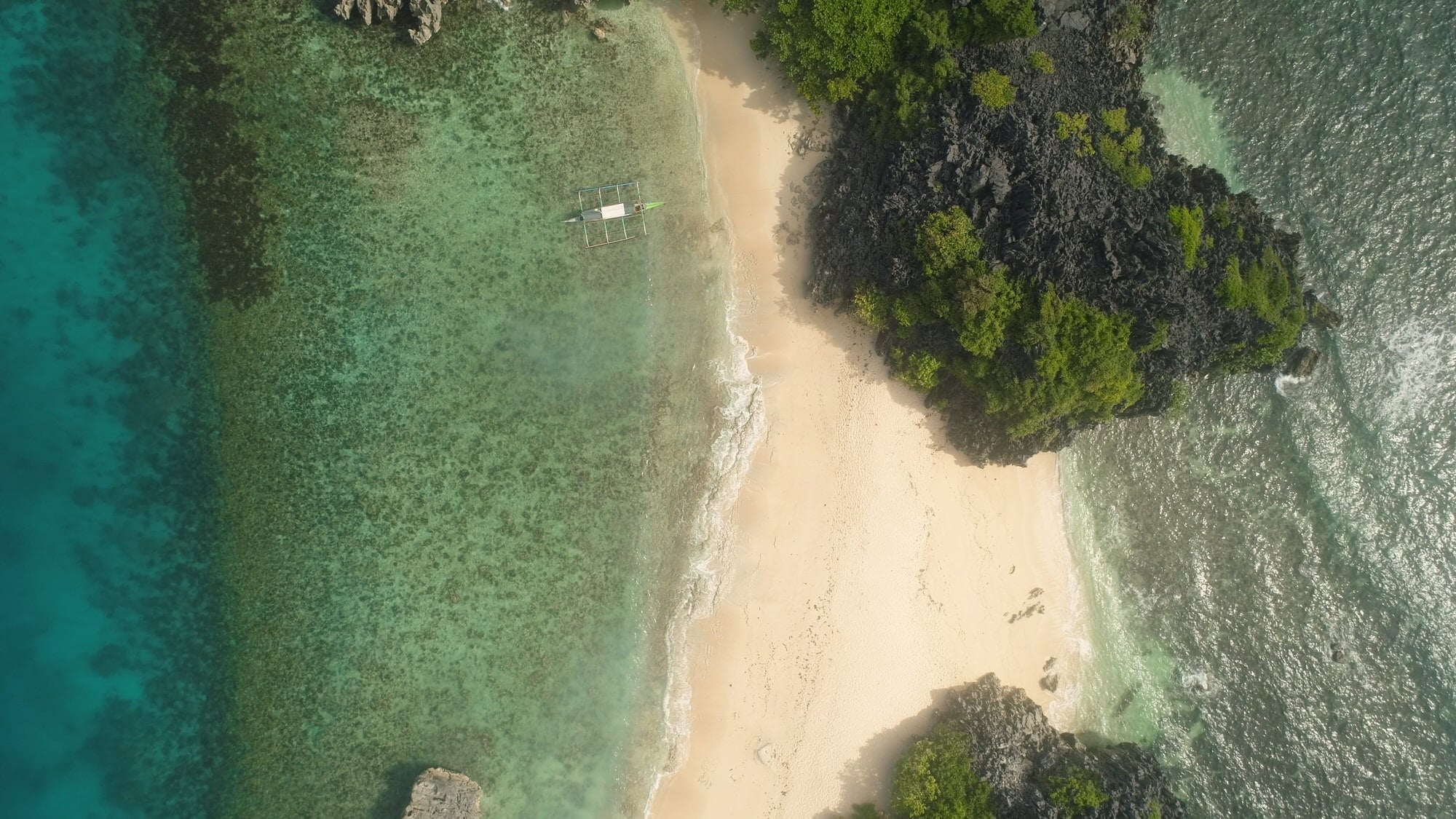 Aerial shot of a beach on the Caramoan Islands, the Philippines
